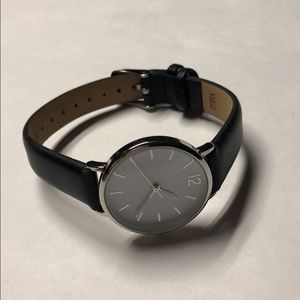 A new day black band woman's watch